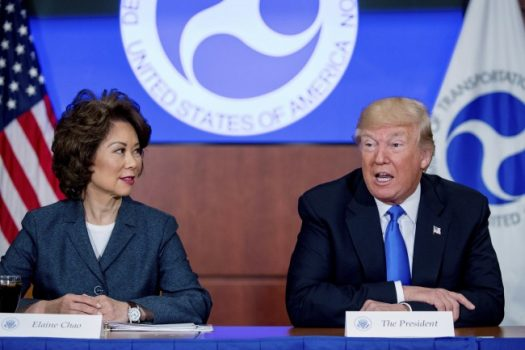President Donald Trump, accompanied by Transportation Secretary Elaine Chao, left, speaks at a roundtable on infrastructure at the Department of Transportation, Friday, June 9, 2017, in Washington. (Andrew Harnik/Associated Press)