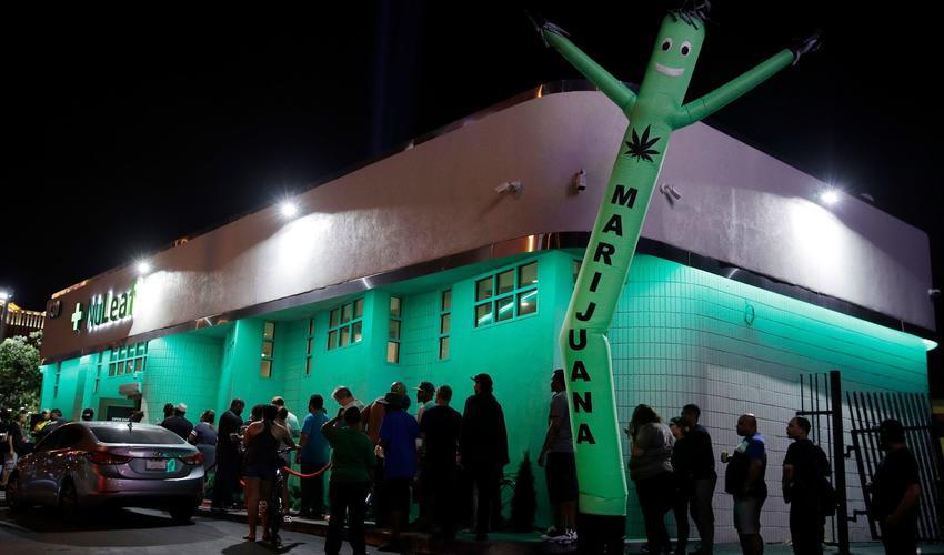 Customers wait in line July 1 at the NuLeaf marijuana dispensary in Las Vegas. (John Locher / Associated Press)