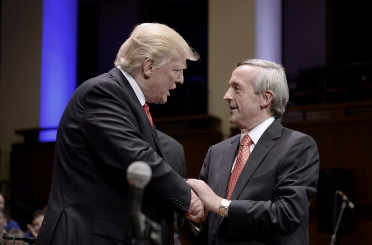 President Trump is greeted by the Rev. Robert Jeffress during a Celebrate Freedom Rally at the John F. Kennedy Center for the Performing Arts in Washington on July 1. (Olivier Douliery/European Pressphoto Agency)