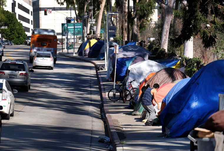 Residents and business owners have taken to social media, and in some cases, submitted petitions and organized protests to demand that city leaders enforce existing city policies that are aimed at removing illegally erected encampments, and hauling away large vehicles that are improperly parked on city streets. (AP File Photo/Richard Vogel)