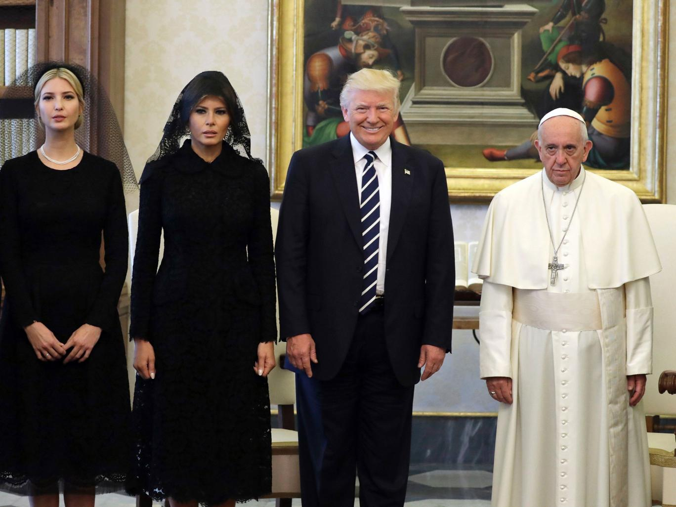 Pope Francis poses with US President Donald Trump, First Lady Melania Trump and the daughter of Ivanka Trump at the end of a private audience at the Vatican (AFP/Getty)