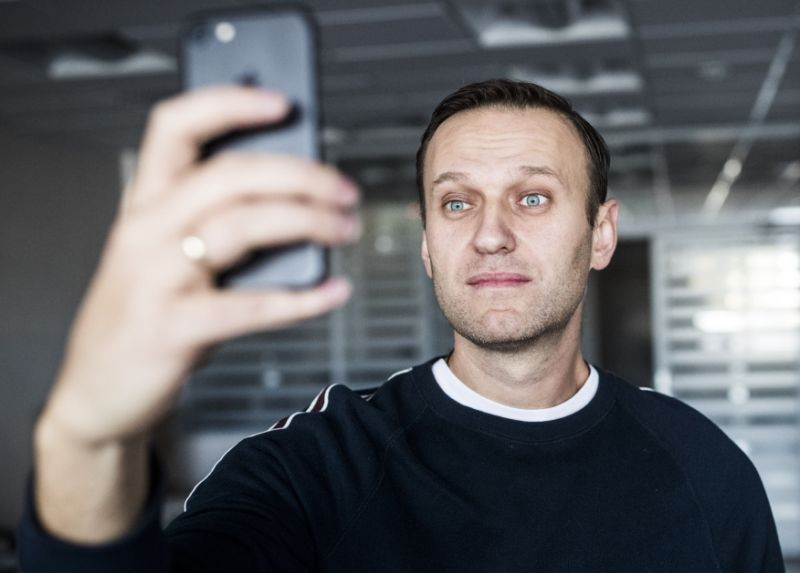 Russian opposition leader Alexei Navalny takes a selfie at his office after been released from a jail in Moscow, Russia, Sunday, Oct. 22, 2017.