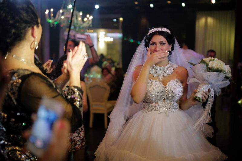 Israeli bride Morel Malcha walked down the aisle with Israeli Arab groom Mahmud Mansur in August 2014 to racist chants by extremists opposed to the marriage of a Jew and a Muslim (AFP Photo/Daniel Bar-On)