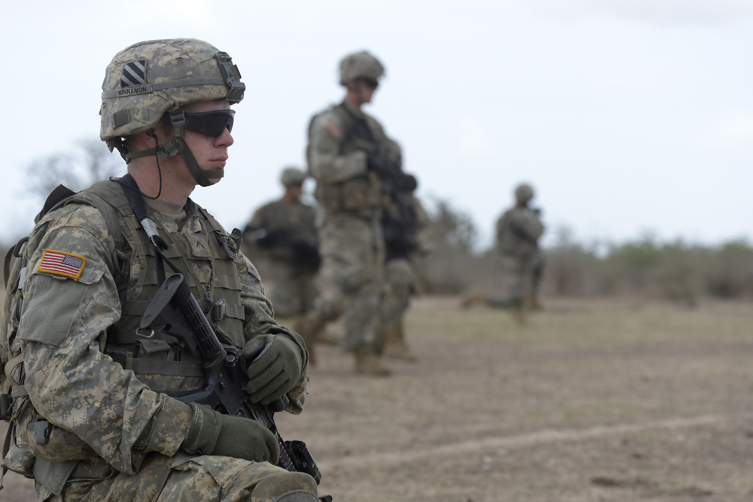An American soldier of 1st Battalion, 30th Infantry Regiment, 2nd Infantry Brigade Combat Team, 3rd Infantry Division takes position during a combined training exercise with Senegalese 1st Paratrooper Battalion in Thies on July 25, 2016.  The first in a series of planned annual USARAF exercises, ART 2016 brings together U.S. Army Soldiers from U.S. Africa Command's Regionally Aligned Force with African partners to increase U.S. and partner readiness through tough and realistic training, including combined live-fire events, counter-improvised explosive device detection and combat casualty care. / AFP / SEYLLOU