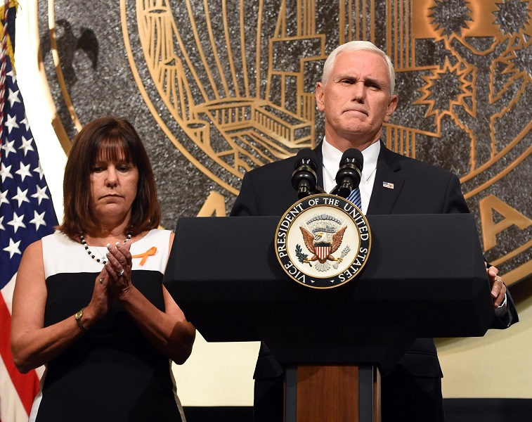 Karen Pence (L) looks on as her husband, U.S. Vice President Mike Pence, speaks at the culmination of a faith unity walk, held to help the community heal after Sunday's mass shooting, at Las Vegas City Hall on October 7, 2017 in Las Vegas, Nevada. (Photo by Ethan Miller/Getty Images)