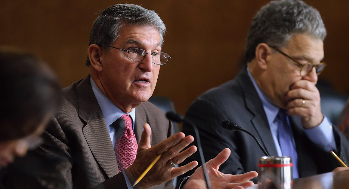West Virginia Sen. Joe Manchin (left) said he hopes Sen. Al Franken (D-Minn) reverses his decision, but even more that the senators who led the charge against him reconsider and call for the two-term senator to stay until the ethics process is complete. | Chip Somodevilla/Getty Images