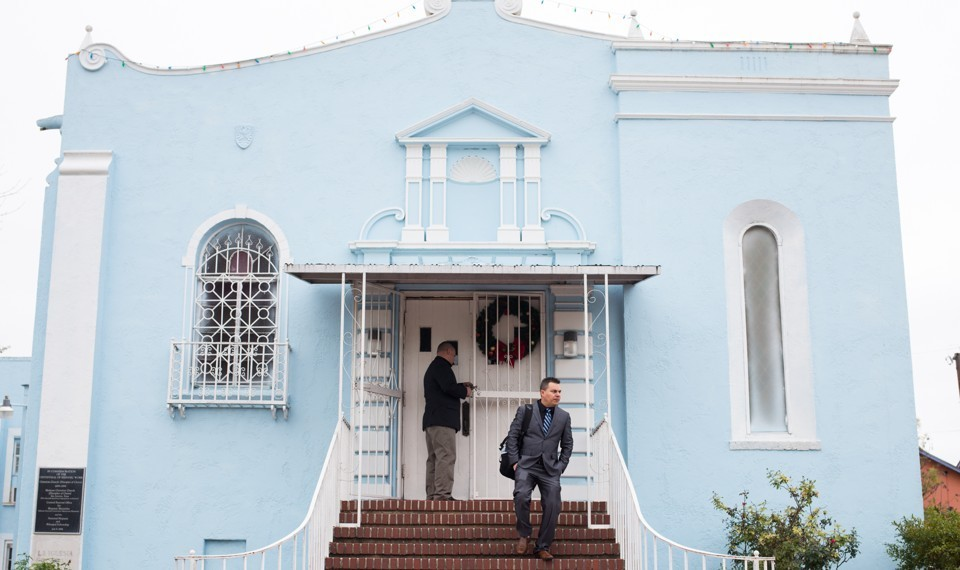 After leading the New Year's Eve service, Pastor Yoan Mora leaves the Primera Iglesia Cristiana in the West Side neighborhood of San Antonio, Texas, on December 31, 2017.