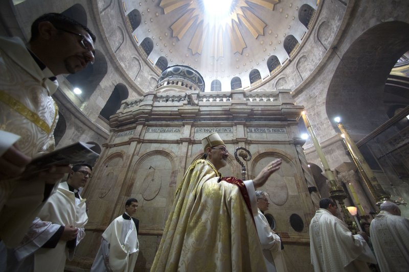 FILE - In this April 16, 2017 file photo, Latin Patriarch of Jerusalem Pierbattista Pizzaballa, center, walks with Christian clergymen on Easter Sunday at the Church of the Holy Sepulchre, in Jerusalem. (AP Photo/Sebastian Scheiner, File)