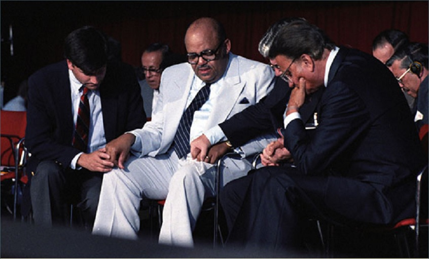 Billy Graham (right) praying with Dr. E.V. Hill, pastor of Mount Zion Missionary Baptist Church