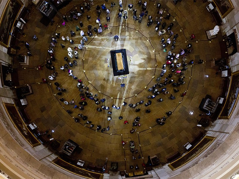Visitors pay their respects as the casket of Billy Graham lies in honor at the the U.S. Capitol Rotunda in Washington on Feb. 28, 2018. It's a rare honor for a private citizen to lie in honor at the Capitol. (AP Photo/Jose Luis Magana)