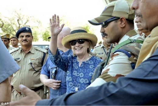 Clinton is pictured above arriving in Jodhpur on Tuesday