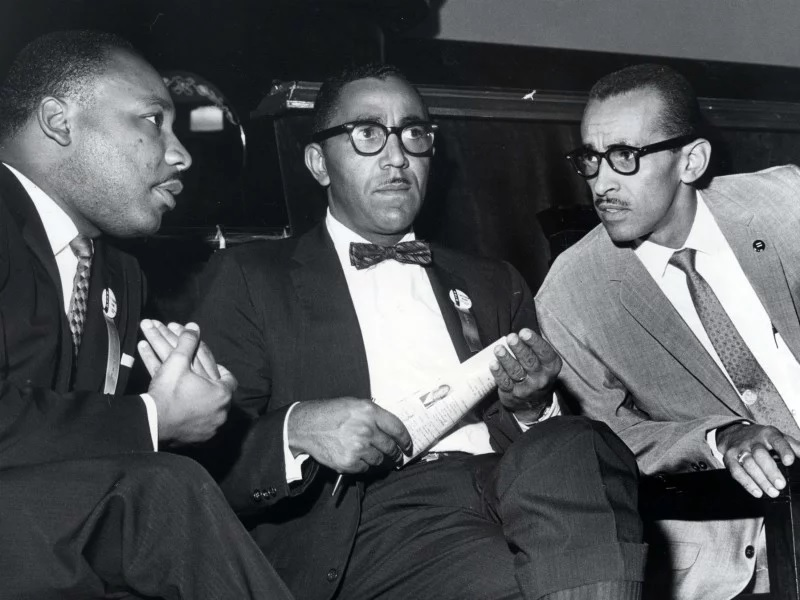 The Rev. Martin Luther King Jr., left, meets with the Rev. Joseph E. Lowery, center, and the Rev. Wyatt Tee Walker at First African Baptist Church in Richmond, Va., for the Southern Christian Leadership Conference convention on Sept. 25, 1963. King was SCLC president at the time, Lowery was vice president and Walker was executive director. (Carl Lynn/Richmond Times-Dispatch via AP)