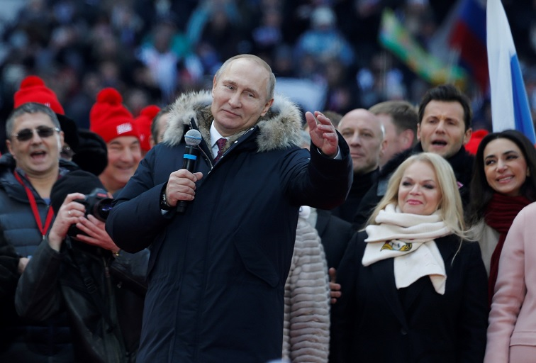 Russia's President Vladimir Putin addresses (C) a rally in his support at the Luzhniki Stadium ahead of the 2018 Russian presidential election scheduled for March 18, in Moscow, Russia on March 03, 2018. (Nataliy Zemboska | Anadolu Agency | Getty Images)