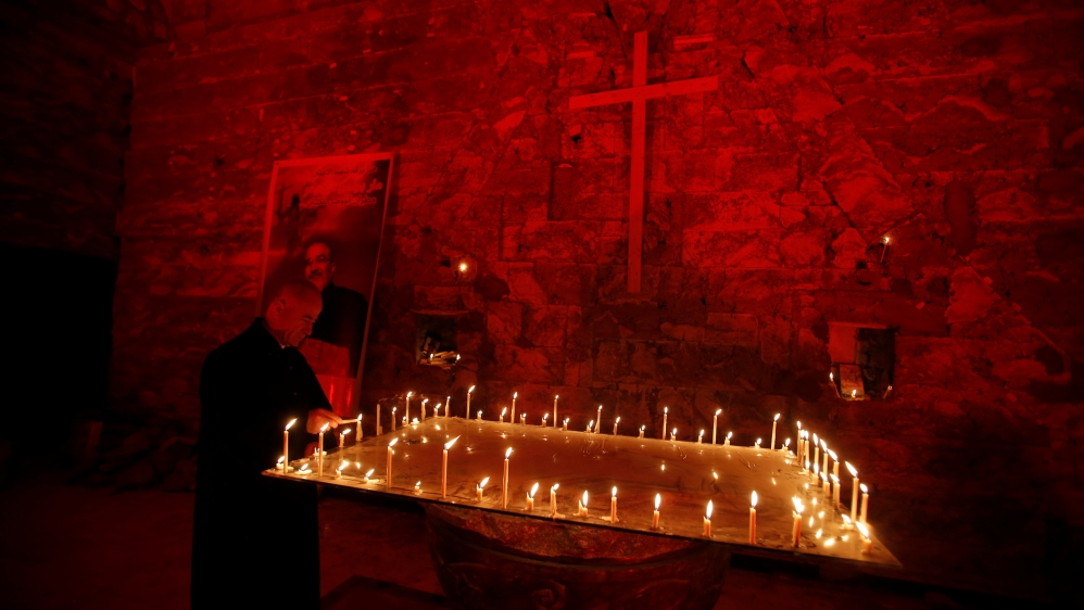 Chaldean Church of St Paul is illuminated with red light in protest against the persecution of Christians around the world [Khalid Al-Mousily/Reuters]