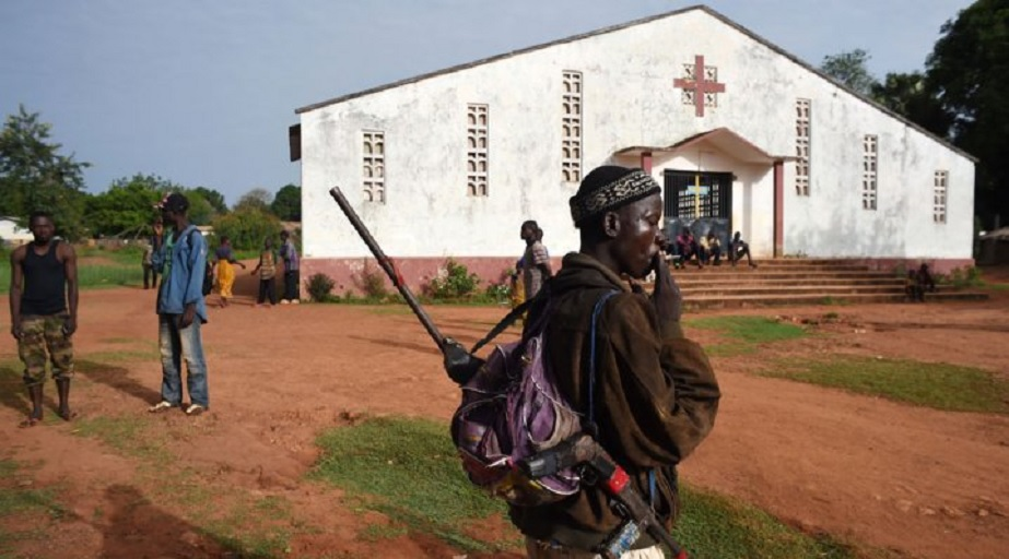 FILE: A soldier patrols by a Central African church, many of which have become refugees. (AFP)