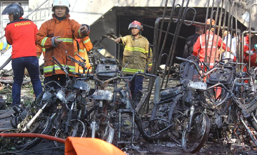 Firefighters clear debris outside the Pentecostal church in Surabaya. (Photograph: Antara Foto/Reuters)