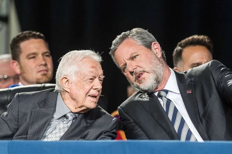 Former President Jimmy Carter, left, talks with Liberty University President Jerry Falwell Jr. during the 45th commencement ceremony at Liberty on May 19, 2018, in Lynchburg, Va. (Lathan Goumas/The News & Advance via AP)