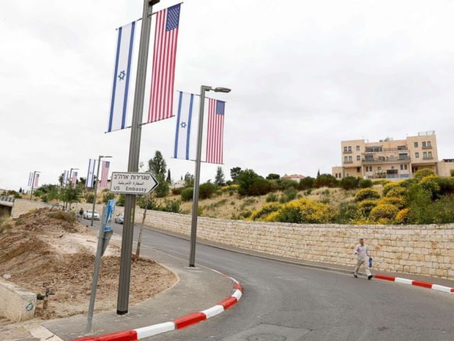 A new road sign and flags are placed at the road leading to the U.S. consulate in the Jewish neighborhood of Arnona on the East-West Jerusalem line in Jerusalem, May 8, 2018.