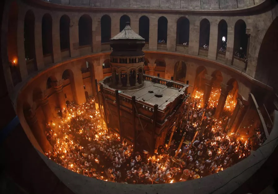 Worshippers hold candles as they take part in the Christian Orthodox Holy Fire ceremony at the Church of the Holy Sepulchre in Jerusalem's Old city May 4, 2013. (Photo credit: REUTERS/AMMAR AWAD)