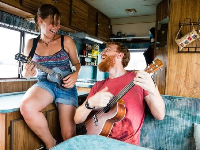 Route 66 connects people from all across the globe. Travelers Natalie Rayner and William Barnett play the ukulele inside their RV as they venture across the Main Street of America. (Photo: David Kafer)