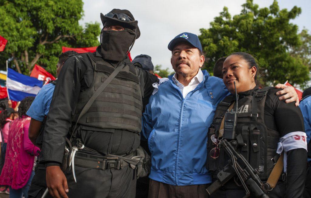 Nicaraguan police pose with President Daniel Ortega, in Masaya, Nicaragua, on Friday. (Associated Press/Cristobal Venegas)