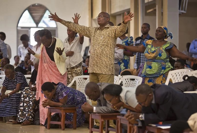 Rwandans sing and pray at the Evangelical Restoration Church in the Kimisagara neighborhood of the capital, Kigali, Rwanda, on April 6, 2014. Rwanda's government closed hundreds of churches and dozens of mosques in 2018, as it seeks to assert more control over a vibrant religious community whose sometimes makeshift operations, authorities say, have threatened the lives of followers. (AP Photo/Ben Curtis)