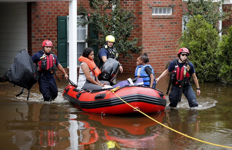 Rescue personnel evacuate residents as flooding continues in the aftermath of Hurricane Florence in Spring Lake, N.C., Monday, Sept. 17, 2018. (AP Photo/David Goldman)