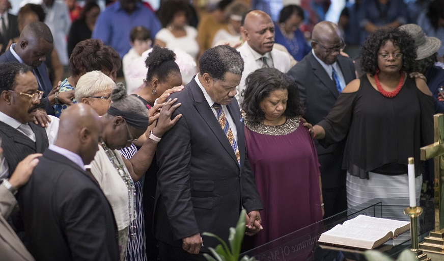 Assistant pastors Nell Collier and her husband, Ron, and Amos Stevenson of Greater Friendship Missionary Baptist Church participated in a Sunday worship service. (Credit: Jerry Holt, Star Tribune(