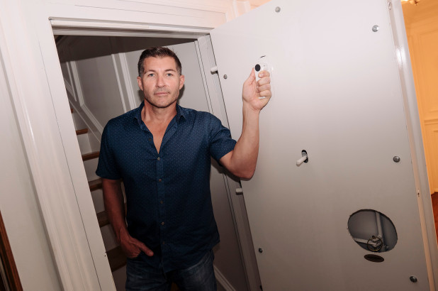 Chris Cosban of Covert Interiors heads inside a panic room he built in a home he sold to a friend. (Stefano Giovannini)