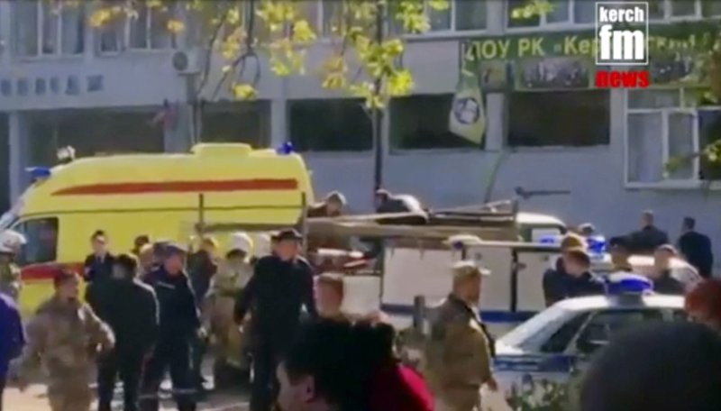 In this image made from video, showing the scene as emergency services load an injured person onto a truck, in Kerch, Crimea, Wednesday Oct. 17, 2018. An explosive device has killed several people and injured at least 50 others at a vocational college in Crimea Wednesday in what Russian officials have called a possible terrorist attack. (Kerch FM News via AP)