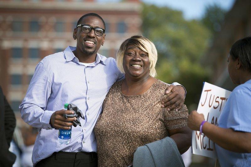 FILE - In this Oct. 13, 2017, file photo, Lamonte McIntyre, who was imprisoned for 23 years for a 1994 double murder in Kansas that he always said he didn't commit, walks out of a courthouse in Kansas City, Kan., with his mother, Rosie McIntyre, after Wyandotte County District Attorney Mark A. Dupree, Sr. dropped the charges. McIntyre and his mother, filed a lawsuit Thursday, Oct. 11, 2018 in federal court alleging Lamonte McIntyre was targeted after his mother rebuffed a homicide detective's sexual advances.(Tammy Ljungblad /The Kansas City Star via AP, File)