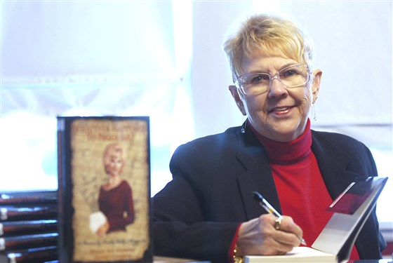 "Peggy Sue Gerron unveils her new book ""What Ever Happened to Peggy Sue"" during a press conference in Tyler, Texas, on Jan. 11, 2008. (Jaime R. Carrero / Tyler Morning Telegraph via AP)"