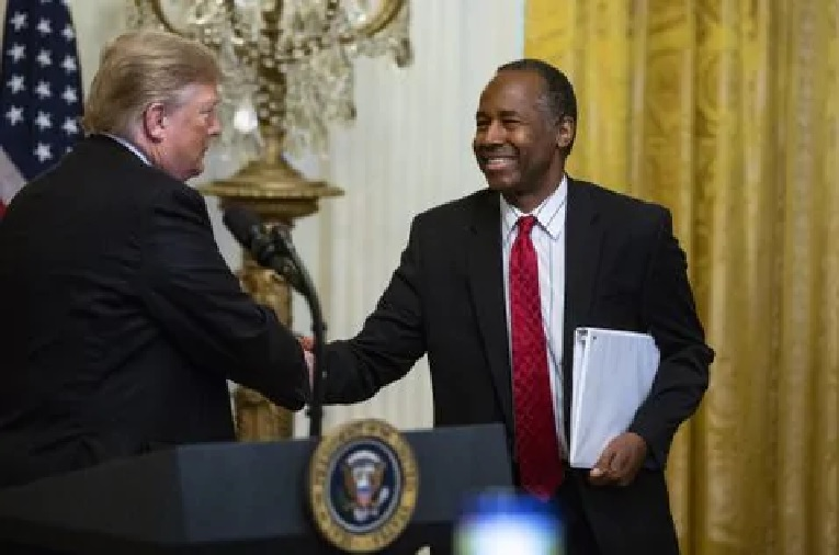 President Trump shakes hands with Ben Carson, secretary of housing and urban development, during the 2018 Young Black Leadership Summit at the White House. (Photographer: Al Drago/Bloomberg)