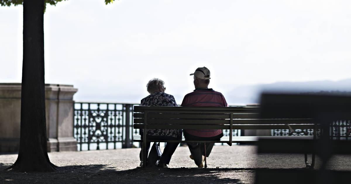 An elderly couple sit on a bench by Lake Zurich in Zurich, Switzerland (Photographer: Michele Limina/Bloomberg)
