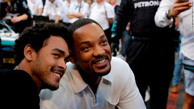 US actor Will Smith (R) and his son Trey visit the pit lane during the Abu Dhabi Formula One Grand Prix at the Yas Marina circuit on November 25, 2018, in Abu Dhabi. (Photo by Luca Bruno / POOL / AFP)