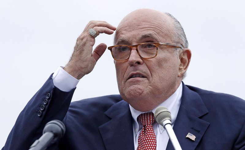 "FILE - In this Aug. 1, 2018 file photo, Rudy Giuliani, an attorney for President Donald Trump, addresses a gathering during a campaign event fin Portsmouth, N.H. Giuliani says he's never said there was no collusion between Russia and members of the Trump campaign. Giuliani's comments Wednesday night on CNN directly contradict the position of his own client, who has repeatedly insisted that there was no collusion during his successful 2016 presidential campaign. Giuliani himself has described the idea of Russian collusion as ""total fake news."" (AP Photo/Charles Krupa, File )"