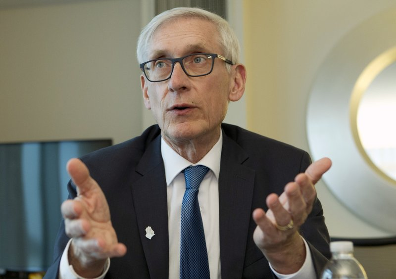 ILE - In this Feb. 23, 2019 file photo, Wisconsin Gov. Tony Evers speaks during an interview during the National Governors Association 2019 winter meeting in Washington. Evers wants to cap enrollment in Wisconsin's private voucher school program, ending expansions that Republicans have enacted over the past eight years. The proposal will be a part of Evers' two-year state budget that he releases on Thursday, Feb. 28. (AP Photo/Jose Luis Magana, File)