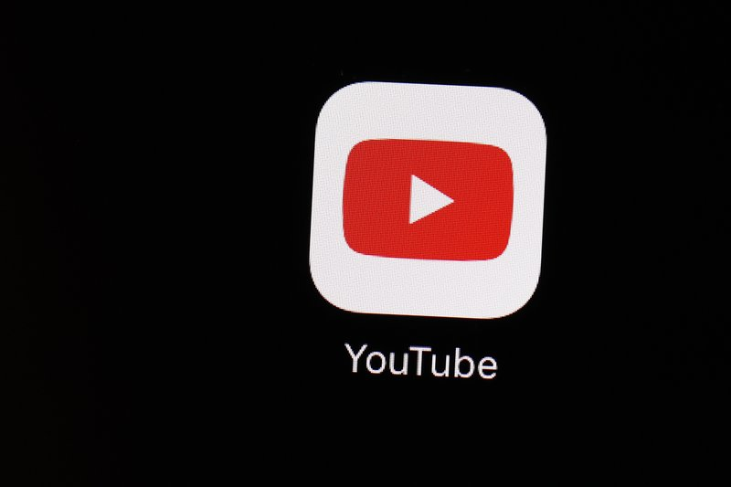 FILE - This March 20, 2018 file photo shows the YouTube app on an iPad in Baltimore. YouTube says it will turn off comments on most videos that feature kids. The change comes after advertisers began boycotting the site last week in response to inappropriate comments made on videos of minors. (AP Photo/Patrick Semansky, File)