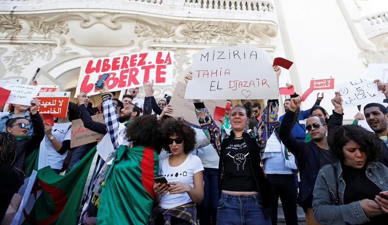 People take part in a protest against Algerian President Abdelaziz Bouteflika seeking a fifth term in a presidential election set for April 18, in Tunis, Tunisia, March 9, 2019. REUTERS/Zoubeir Souissi