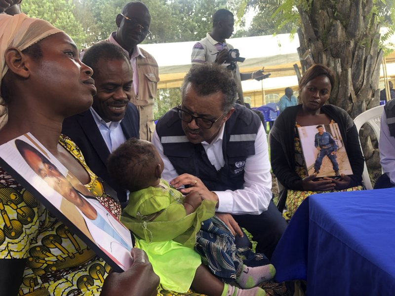 WHO Director-General, Dr Tedros Adhanom Ghebreyesus and DRC Ministry of Health, Dr Oly meet with widows who lost their husbands to conflict during a visit to an Ebola treatment centre in Butembo, in the Democratic Republic of the Congo, Saturday March 9, 2019. Armed assailants again attacked an Ebola treatment center in the heart of eastern Congo's deadly outbreak on Saturday, with one police officer killed and health workers injured. (Dalia Lourenco/WHO via AP)