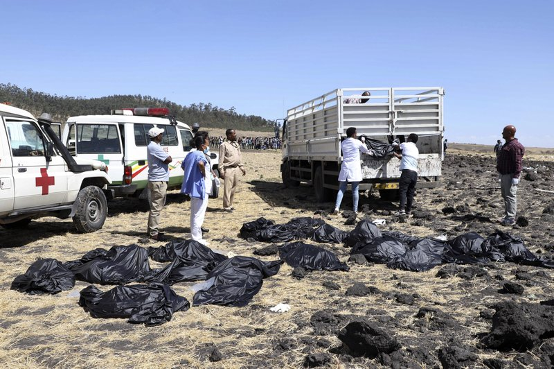 Rescuers remove body bags from the scene of an Ethiopian Airlines flight that crashed shortly after takeoff at Hejere near Bishoftu, or Debre Zeit, some 50 kilometers (31 miles) south of Addis Ababa, in Ethiopia Sunday, March 10, 2019. The Ethiopian Airlines flight crashed shortly after takeoff from Ethiopia's capital on Sunday morning, killing all 157 on board, authorities said, as grieving families rushed to airports in Addis Ababa and the destination, Nairobi. (AP Photo)