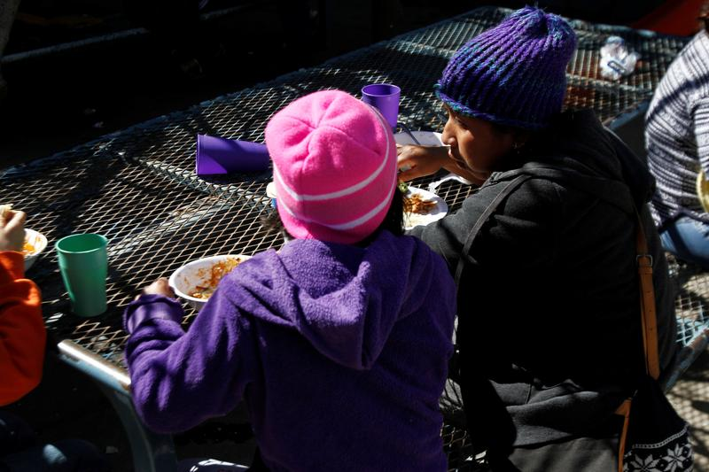 FILE PHOTO: Central American migrants, waiting in Mexico while their asylum request is processed under a new U.S. policy, eat at a shelter in Tijuana, Mexico February 19, 2019. REUTERS/Jorge Duenes