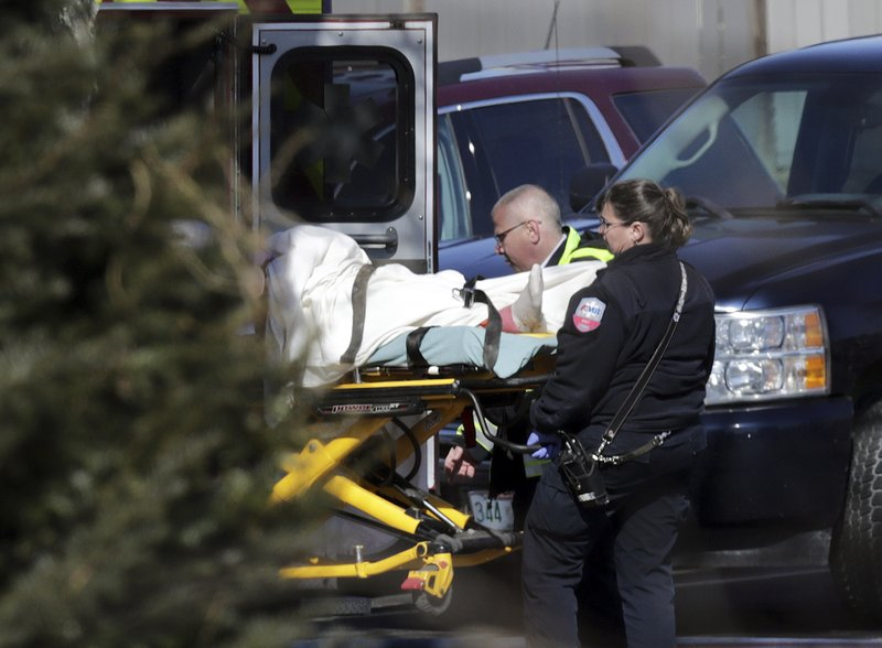 Emergency medical technicians carry a person on a stretcher into an ambulance outside the Quality Inn on Thursday, March 28, 2019, in Manchester, N.H. Two people had barricaded themselves in a first-floor room after one man was shot and killed there Wednesday night by police after he engaged Drug Enforcement Administration agents and police. (AP Photo/Charles Krupa)
