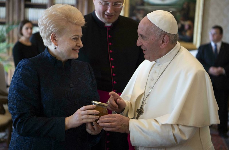 Pope Francis and Lithuania President Dalia Grybauskaite exchange gifts during their private audience at the Vatican, Thursday, March 28, 2019. (Maurizio Brambatti/Pool photo via AP)