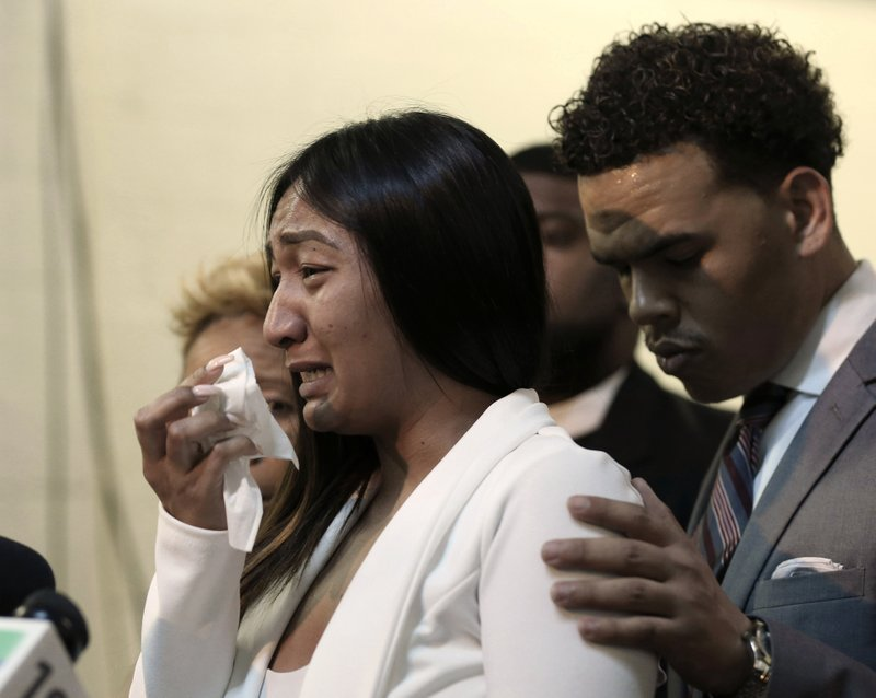 Salena Manni, the fiancee of Stephon Clark, who was shot and killed by Sacramento police in 2018, cries as she discusses the decision to not file charges against the two officers involved, during a news conference in Sacramento, Calif., Saturday, March 2, 2019. Sacramento County District Attorney Anne Marie Schubert announced that Officers Terrance Mercadal and Jared Robinet did not break any laws when they shot Clark after the 22-year-old vandalism suspect ran from them into his grandparents' backyard. (AP Photo/Rich Pedroncelli)