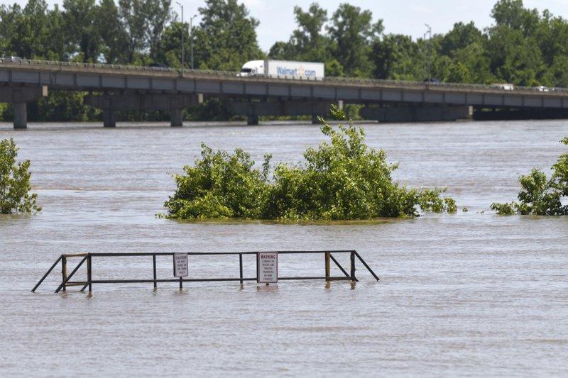 Traffic moves over the I-540 bridge as the Arkansas River floods along Adams Street Thursday, May 30, 2019, in Van Buren, Ark. (AP Photo/Michael Woods)