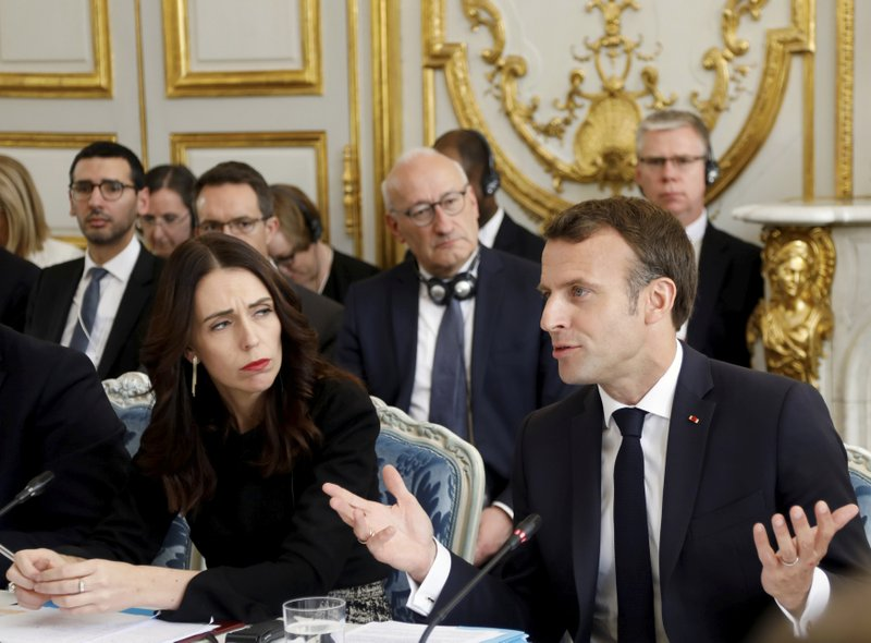 French President Emmanuel Macron and New Zealand's Prime Minister Jacinda Ardern attend a meeting at the Elysee Palace, Wednesday, May 15, 2019 in Paris. Several world leaders and tech bosses are meeting in Paris to find ways to stop acts of violent extremism from being shown online. (Charles Platiau/Pool via AP)