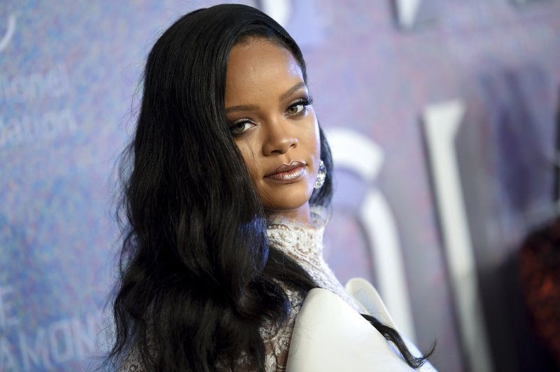 FILE - In this Sept. 13, 2018 file photo, singer Rihanna attends the 4th annual Diamond Ball at Cipriani Wall Street in New York. Rihanna is partnering with LVMH Moët Hennessy Louis Vuitton to launch a new fashion label. The pop star, born Robyn Rihanna Fenty, announced Friday, May 10, 2019, that a new line called Fenty will debut this spring and will be based in Paris. (Photo by Evan Agostini/Invision/AP, File)