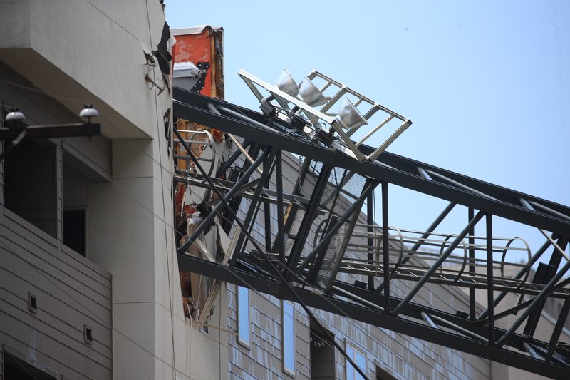 Officials respond to the scene after a crane collapsed into Elan City Lights apartments amid severe thunderstorms, Sunday, June 9, 2019, in Dallas. Injuries were reported Sunday afternoon when storms pummeled parts of North Texas. (Shaban Athuman/The Dallas Morning News via AP)