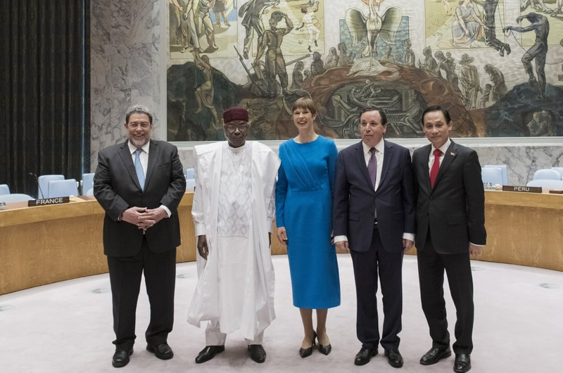 In this photo provided by the United Nations, the newly elected members of the United Nations Security Council pose for a group photo in the Security Council chambers at the United Nations headquarters, Friday, June 7, 2019. From left are St. Vincent and the Grenadines Prime Minister Ralph Gonsalves, Nigerian Foreign Minister Kalla Ankourao, Estonian President Kersti Kaljulaid, Tunisian Foreign Minister Khemaies Jhinaoui and Vietnamese Deputy Foreign Minister Le Hoai Trung. (Mark Garten/The United Nations via AP)